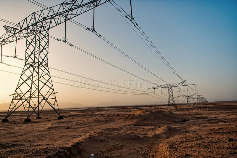 High voltage power lines in desert valley royalty free stock images