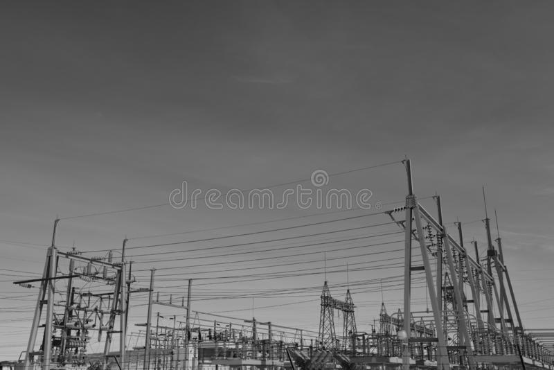 High voltage power lines and electrical power sub station metal structure. High voltage electrical power sub station metal structure and power lines in South stock image