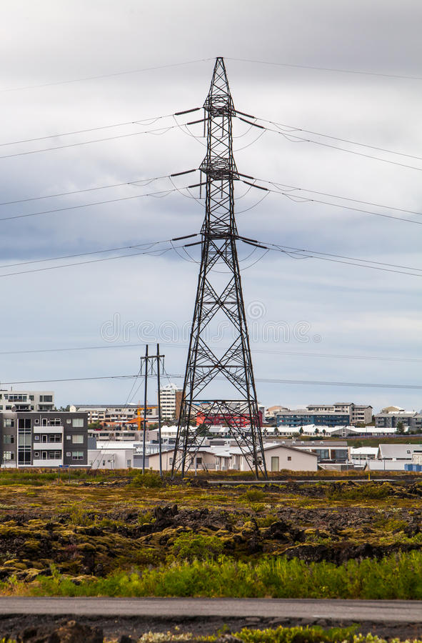 High Voltage Power Lines. And houses in the city royalty free stock photos