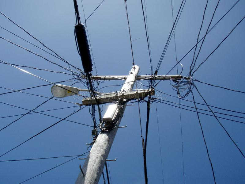 High Voltage Power Lines intersect at a wooden Utility pole. In San Francisco, California, telegraph, tower, overhead, day, urban, telephone, infrastructure stock image