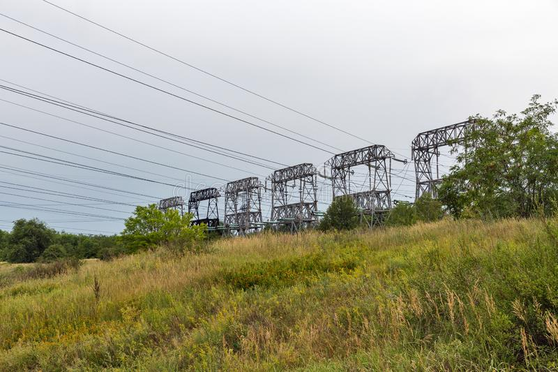High voltage power lines towers on Khortytsia island, Ukraine royalty free stock images