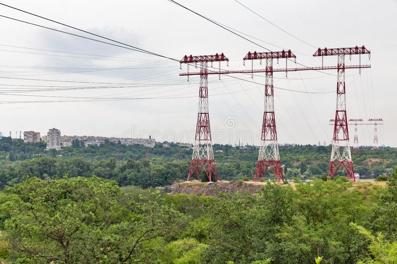 High voltage power lines towers on Khortytsia island, Ukraine. High voltage power lines towers on island of Khortytsia and Dnieper river in Ukraine stock photos