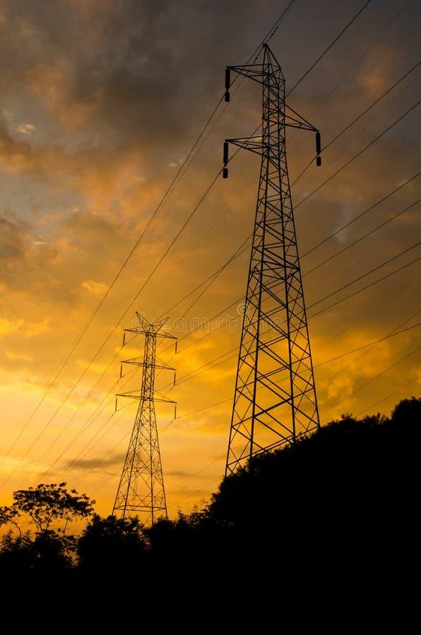 High voltage power pole. High voltage power pole, while the sunrise stock photography