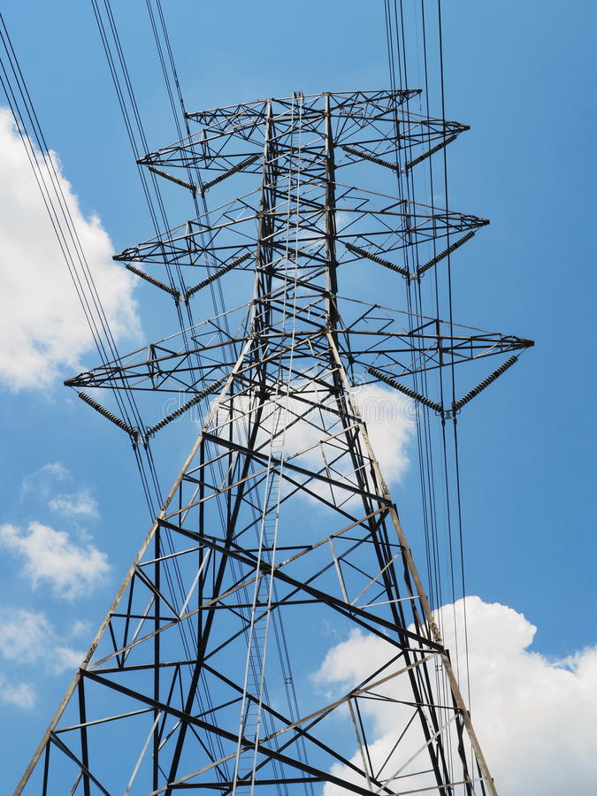High voltage power pole soaring into sky royalty free stock image