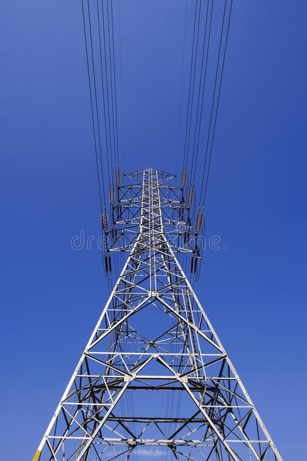High voltage power pole tower with blue sky royalty free stock images
