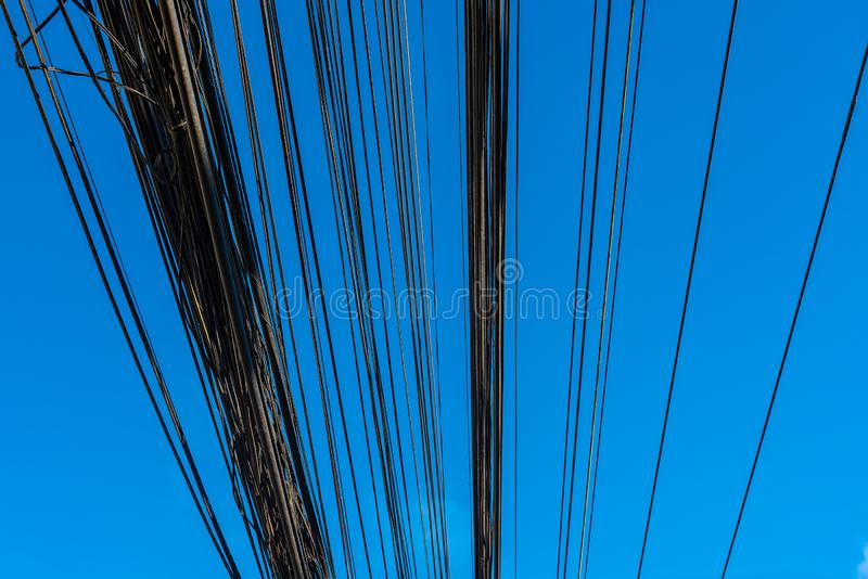 High voltage power pole with wires tangled.Thailand royalty free stock image