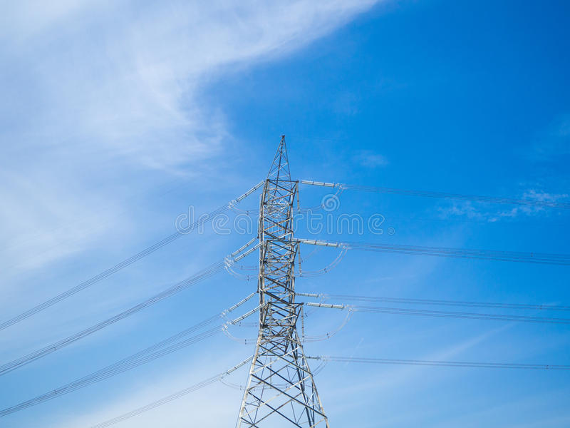 A high voltage power pylons against blue sky royalty free stock photography