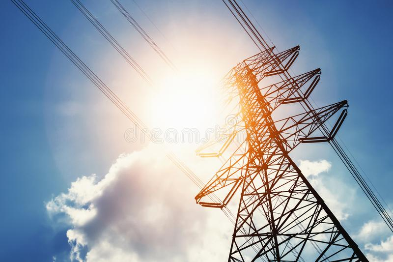 High voltage power and solar energy with blue sky. Background royalty free stock photo