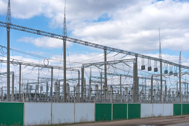 An electricity distribution station in a fenced area royalty free stock image