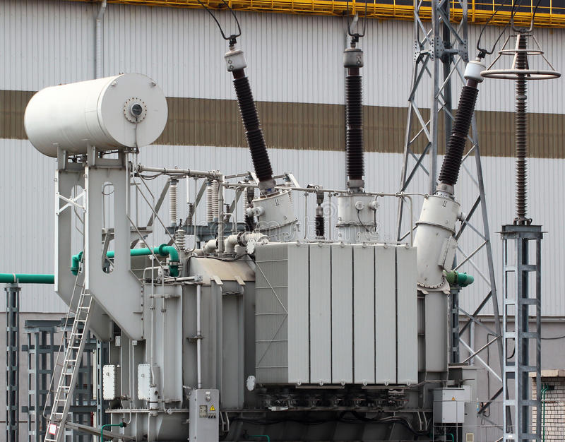 High voltage power transformer on electrical substation stock photos