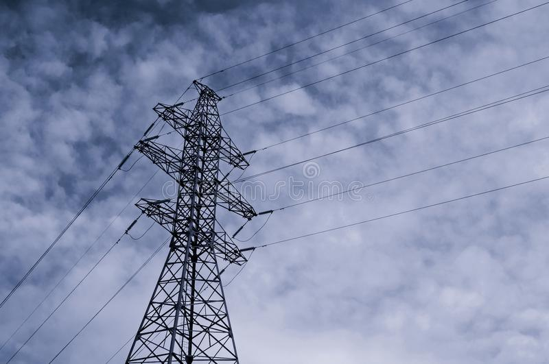 High voltage power transmission line. Industrial background with high voltage tower on the background of blue sky stock photo