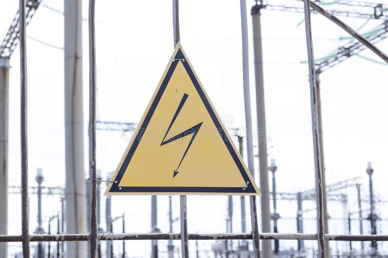 High Voltage Sign and Symbol Caution Signboard on Fence Wire Electrical Power Plant Station. High Voltage Sign and Symbol Caution Signboard on Fence Wire at stock photo
