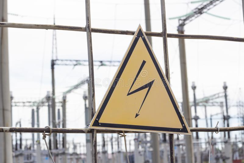 High Voltage Sign and Symbol Caution Signboard on Fence Wire Electrical Power Plant Station. High Voltage Sign and Symbol Caution Signboard on Fence Wire at royalty free stock image