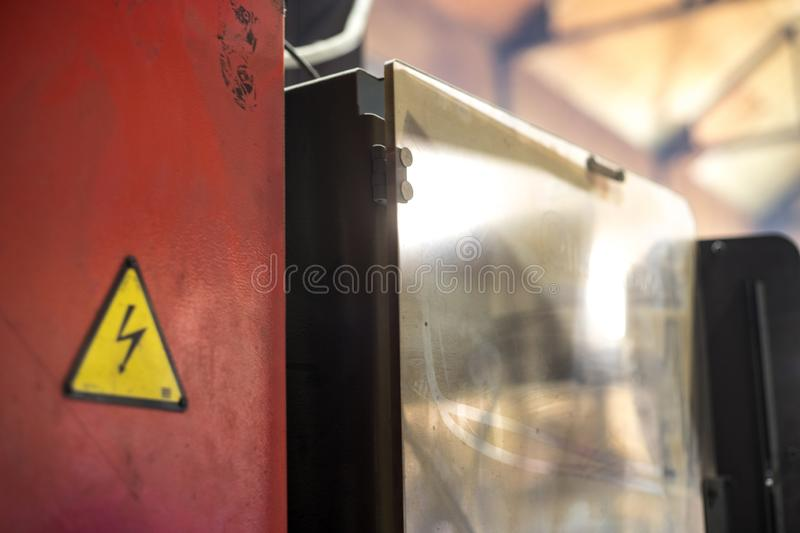 High voltage sign on the transformer door at the metallurgical factory. Close up royalty free stock image