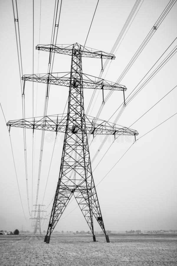 High voltage supply with power lines in wintertime. High voltage mast, electricity supply in all weather conditions picture taken in the Netherlands stock images