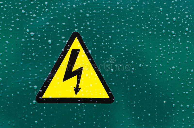 Download High Voltage stock photo. Image of symbol, green, triangle - 35422602