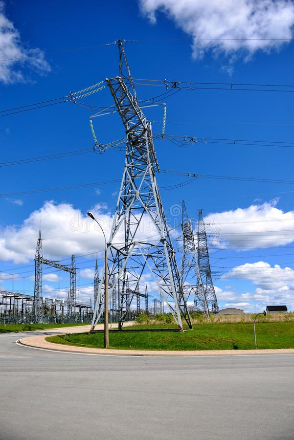 High-voltage tower on green grass and sky in background. - Image.  stock photography