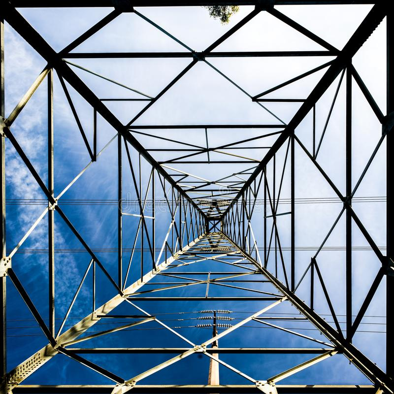 High voltage tower. Looking from the bottom royalty free stock images