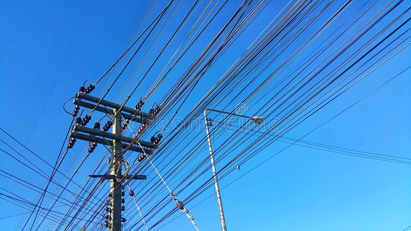 High voltage tower and power cable with blue sky royalty free stock photo