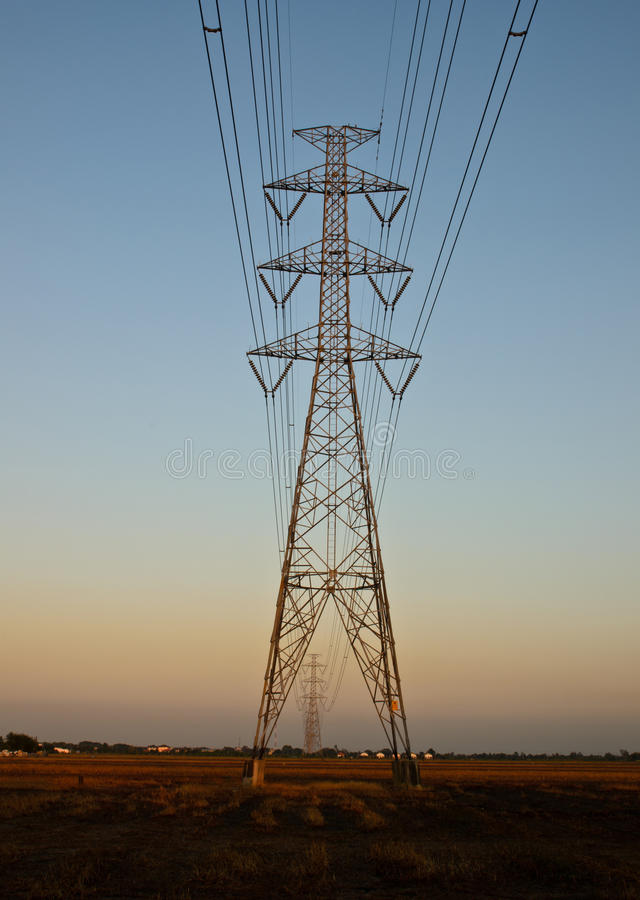 High-voltage Tower On Twilight Stock Photo