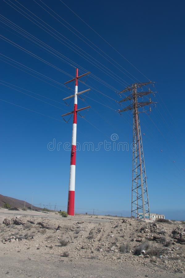 Two impressive towers of high voltage electricity transport. royalty free stock photos