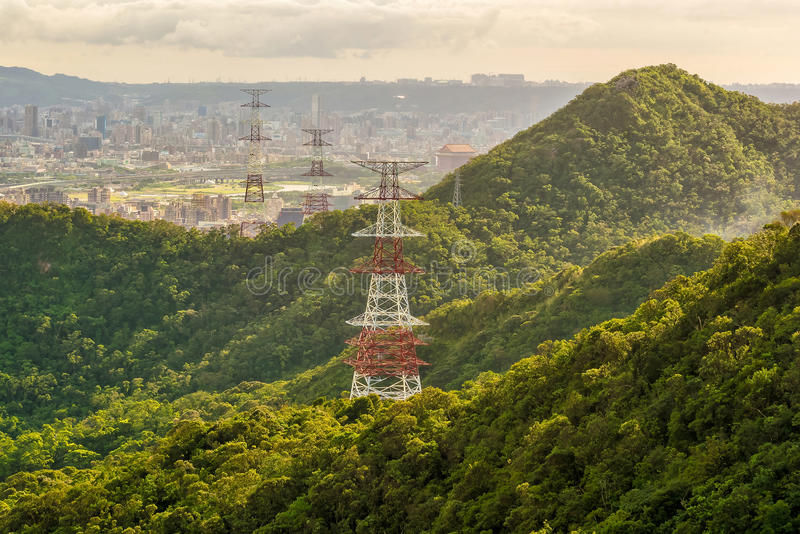 High voltage towers in Taipei, Taiwan. At sunset royalty free stock photo