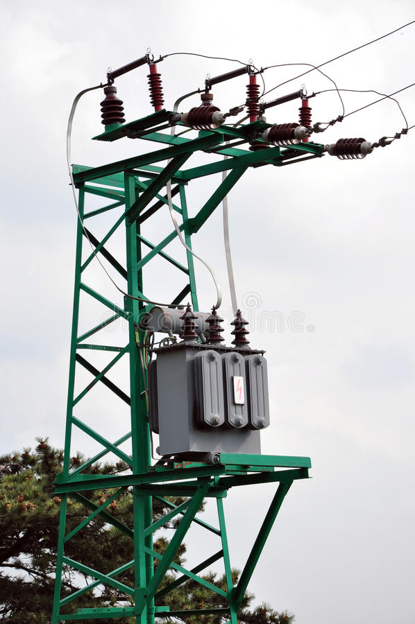 High voltage transformer. Detailed view of the high voltage transformer on the green column stock images