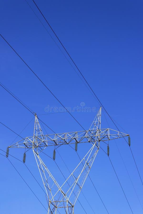 High voltage transmission line pylon. Portrait image.  royalty free stock photo