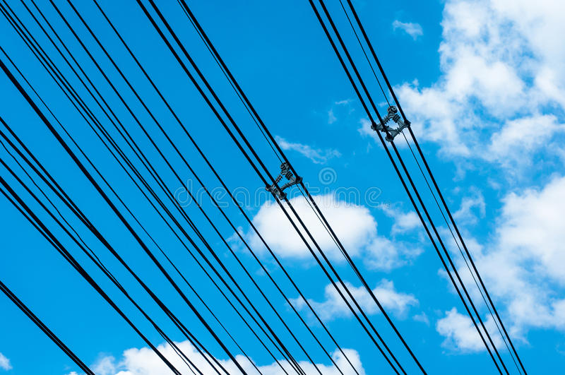 High voltage transmission lines on blue sky stock photos
