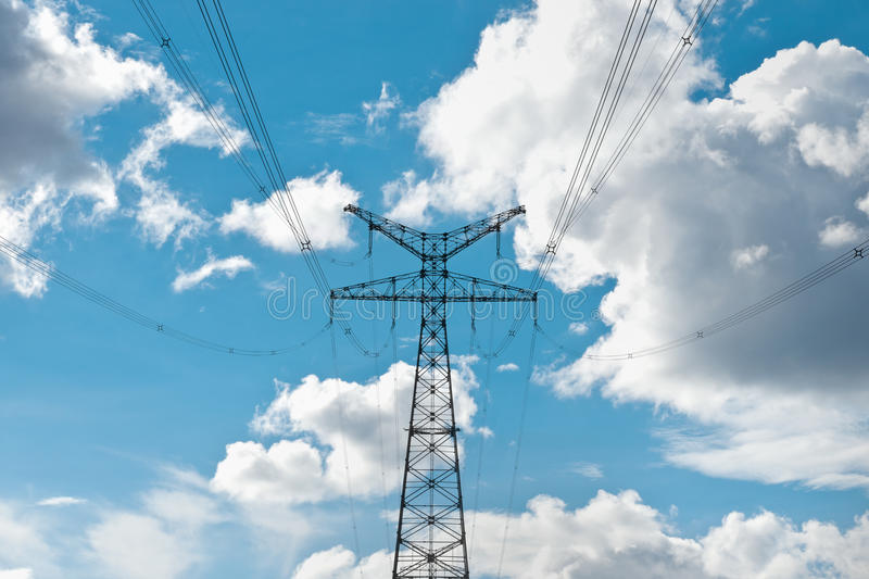High Voltage Under The Blue Sky Stock Photo