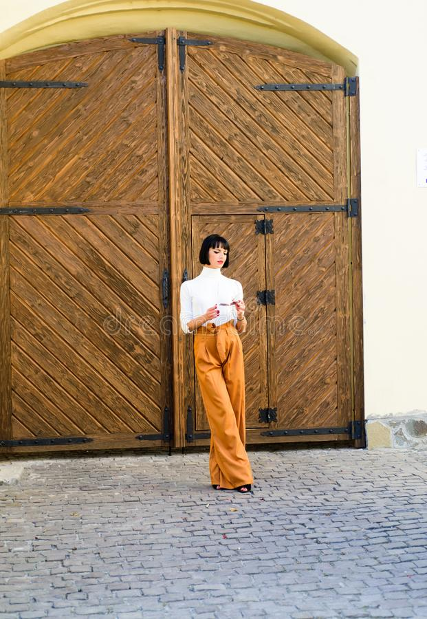 High waisted pants fashion trend. High waisted trousers. Woman attractive brunette wear fashionable clothes. Femininity. And emphasize feminine figure. Girl royalty free stock photo