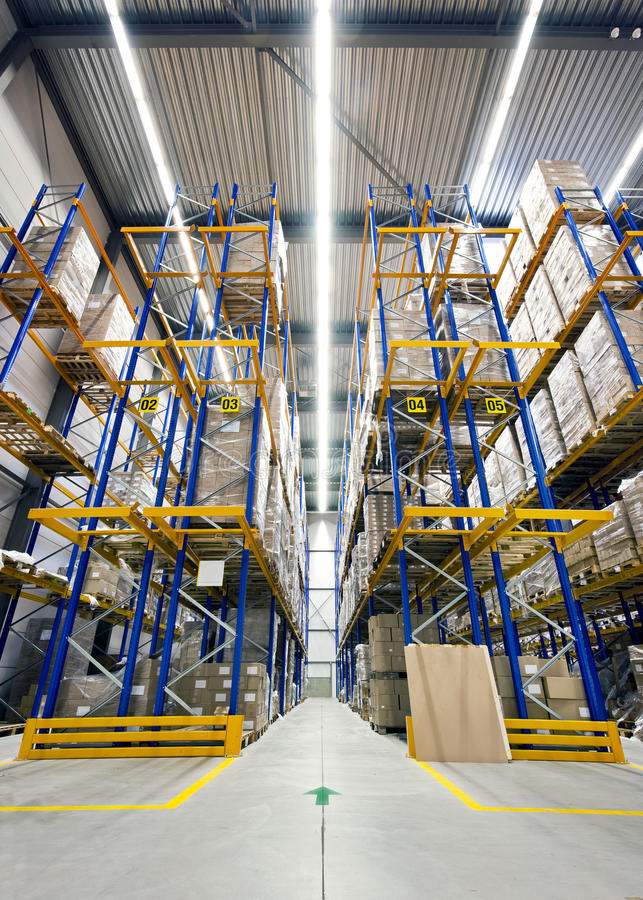 High warehouse. Warehouse with high racks, loaded with boxes, ready to be shipped to customers royalty free stock photos