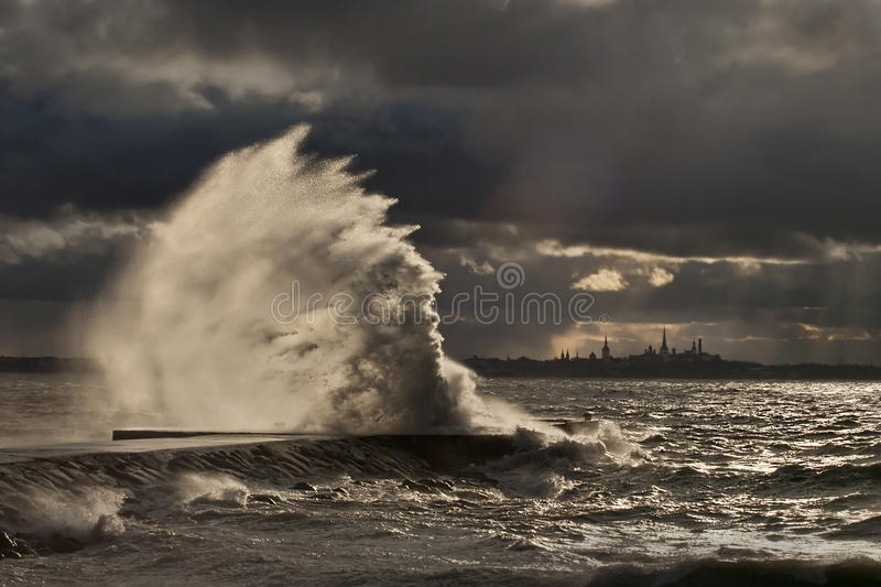 High wave at the pier. In a stormy weather stock photography