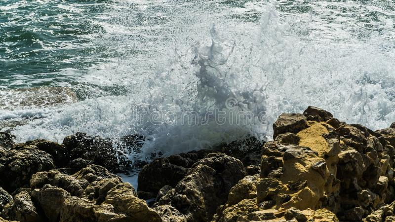 High waves at the coast of mediterranean sea. Spray foam royalty free stock image