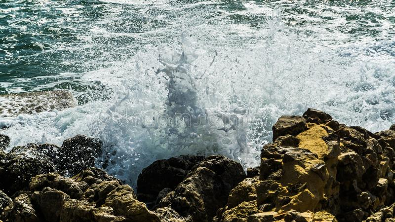 High waves at the coast of mediterranean sea. Spray foam royalty free stock photos