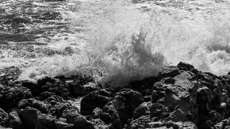 High waves at the coast of mediterranean sea. Spray foam stock image