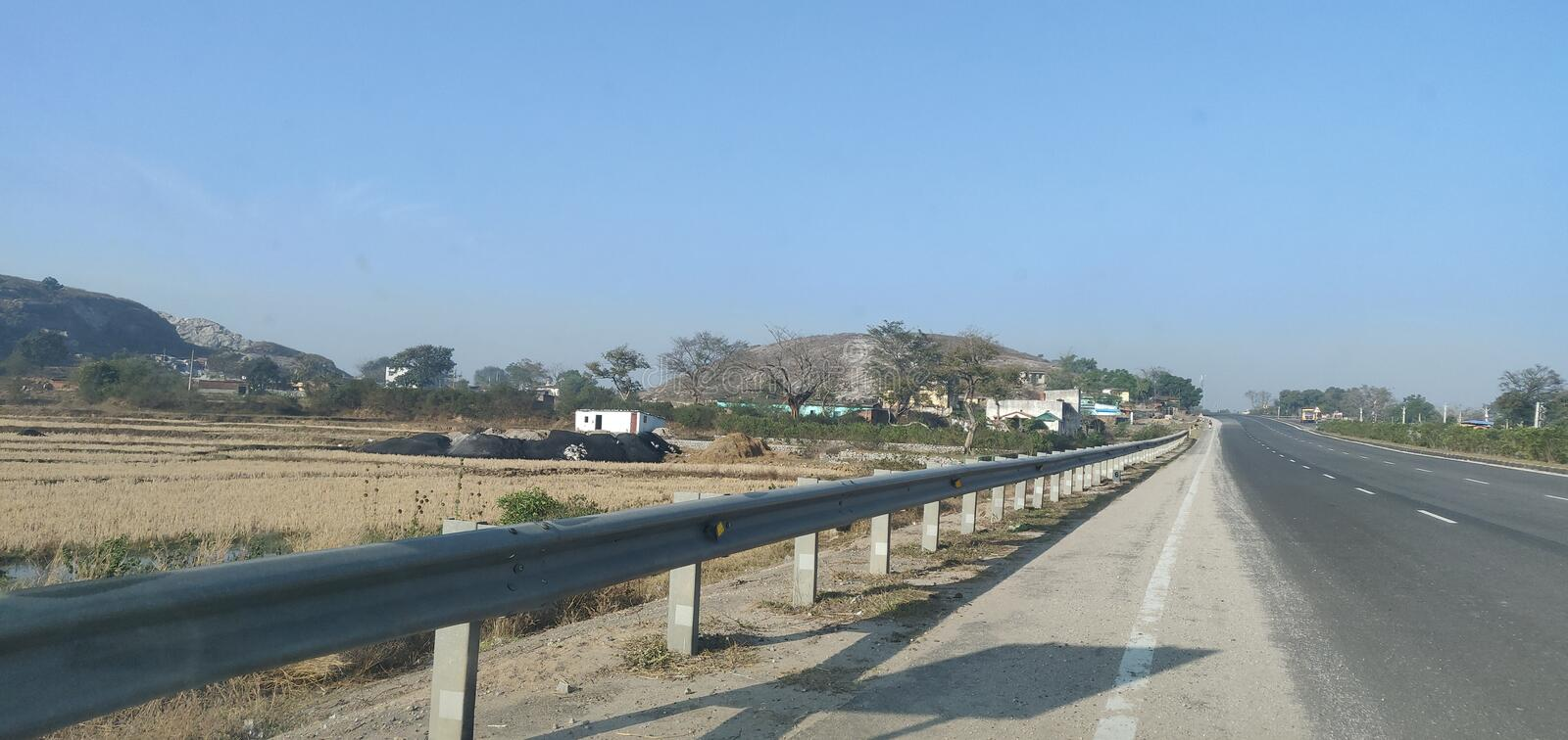 High Way near Balsiring, Ranchi, India captured during day time. Good sceninc beauty stock photography