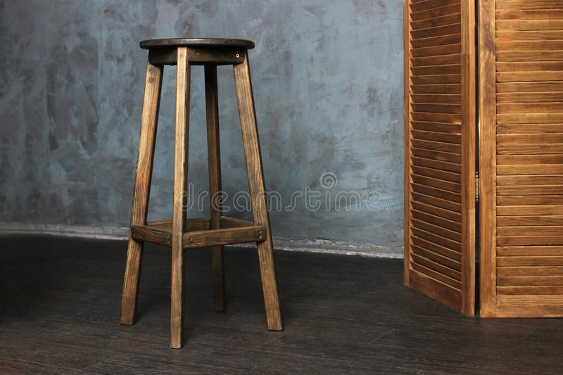 High wooden chair, bar stock images