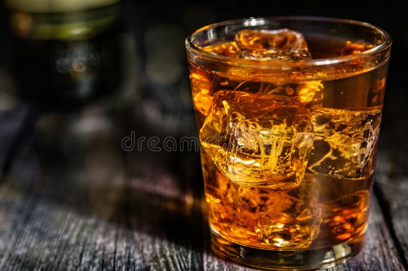 Highball on a wooden bar top stock image