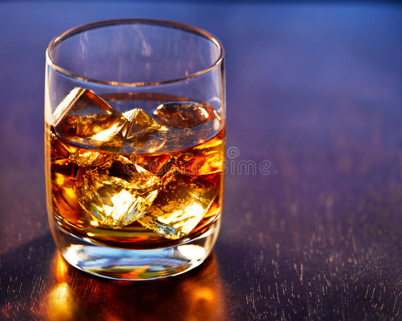 Highball whiskey glass on table stock photography