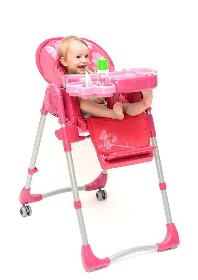 Highchair com bebê fotos de stock