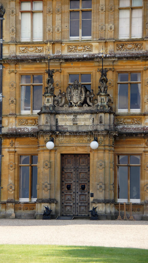 Highclere Castle entrance. The main entrance door of Highclere castle, filming location of Downton Abbey royalty free stock photos