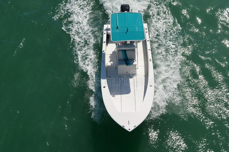 High-End Motor Boat on the Florida Intra-Coastal Waterway. Highend motorboat ;powered by one outboard engine speeding on the Florida Intra-Coastal Waterway stock images