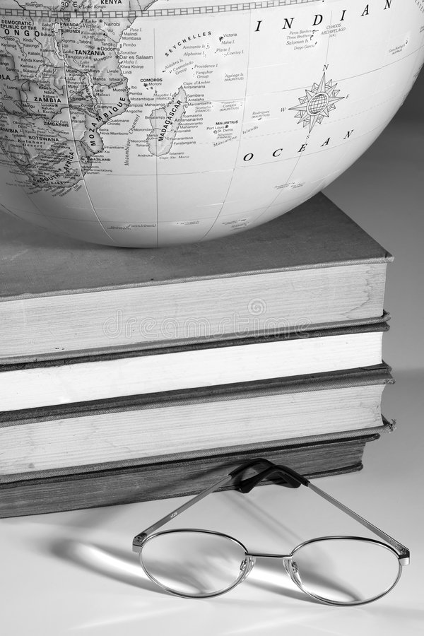 Higher education. Globe, books, and glasses, illustrating higher education stock photography
