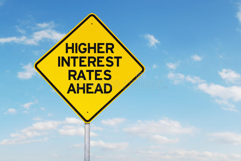 Higher Interest Rates Roadsign. Roadsign of higher interest rates ahead against blue sky royalty free stock photo