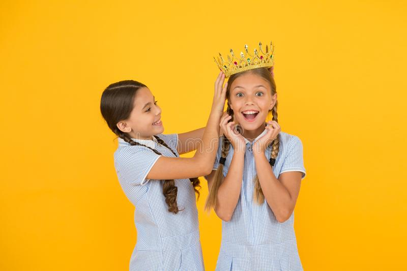 Higher standard. vintage girls in gold crown. motivation to be the best. small egoist girls imagine they princess. Success reward. happy childhood frienship royalty free stock photography