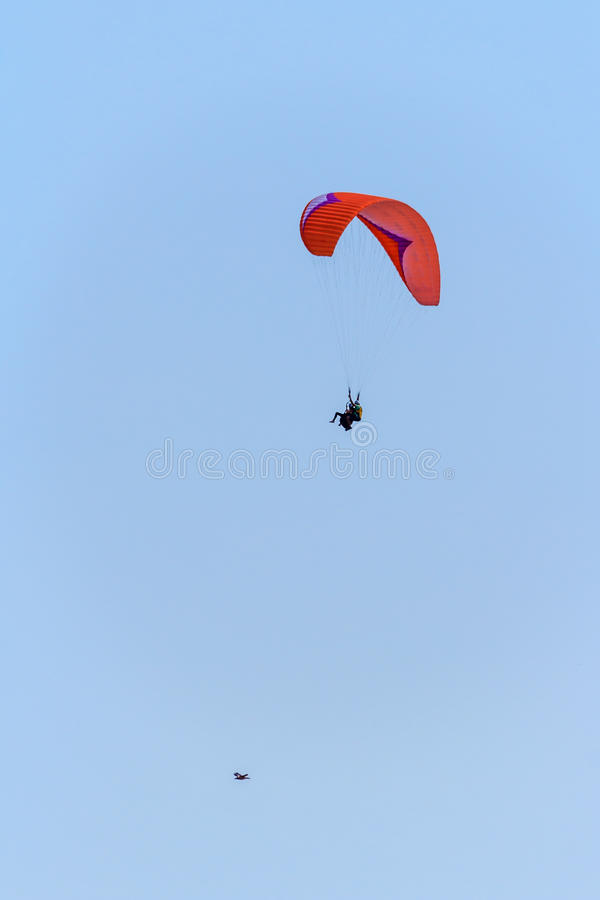 Higher than the birds. Paragliding in the sky royalty free stock photo