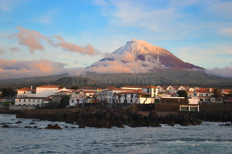 The highest mountain of Portugal, the Azores volcano Montanha do Pico on the island of Pico at sunset royalty free stock image