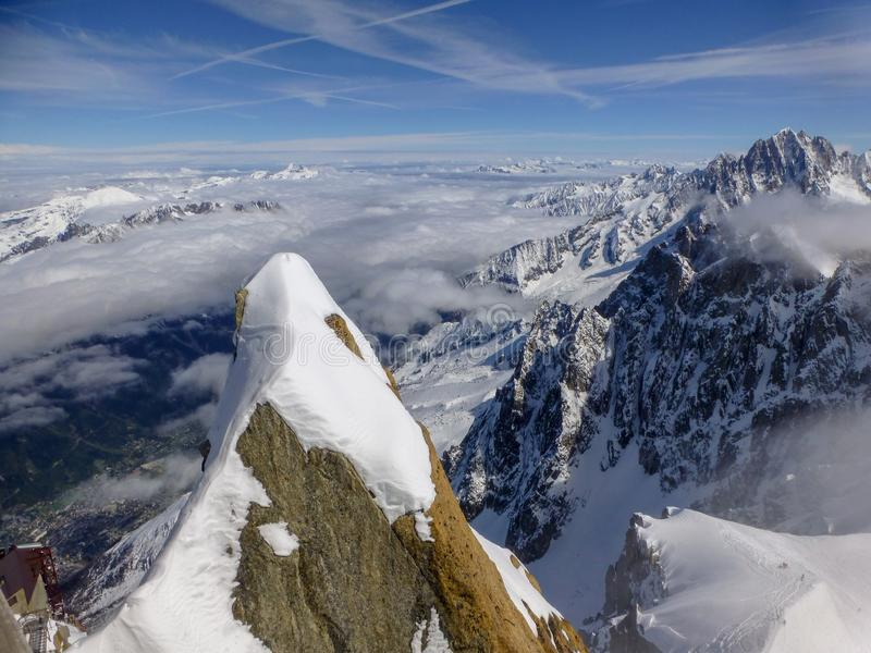 Highest panoramic platform on mountain peak Aiguille du Midi in France above ski village Chamonix Mont-Blanc. View from highest panoramic platform on mountain royalty free stock photos
