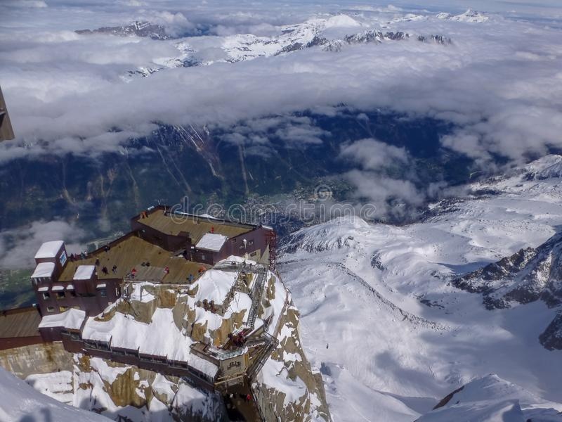 Highest panoramic platform on mountain peak Aiguille du Midi in France above ski village Chamonix Mont-Blanc stock photography